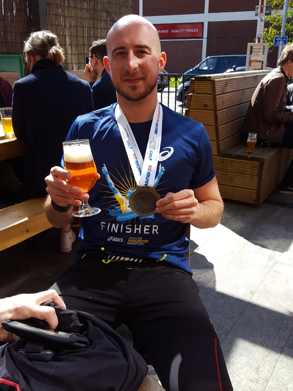 Adam after finishing the Manchester Marathon